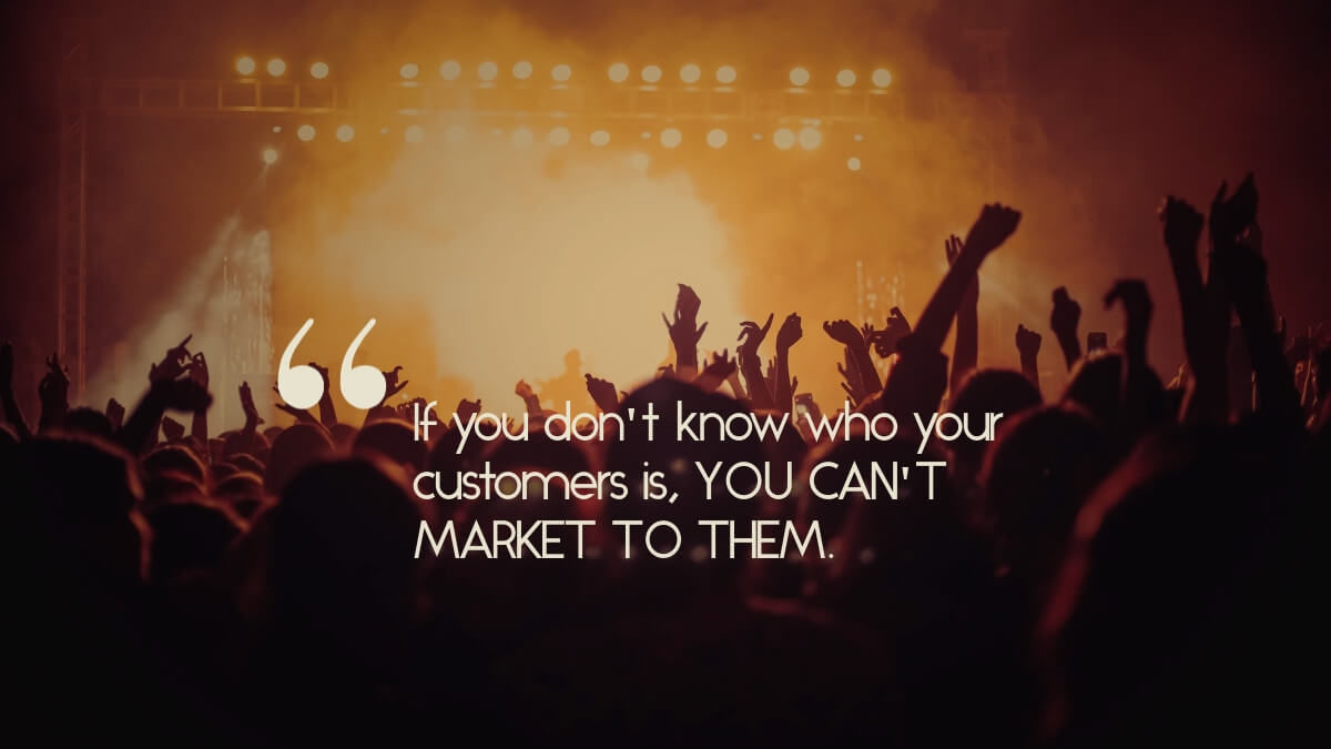 """An audience under a quote that says, """"If you don't know who your customers is, YOU CAN'T MARKET TO THEM."""""""