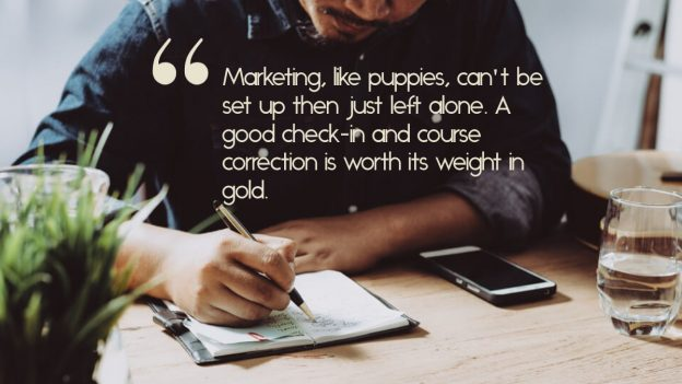 "Man writing in a calendar, with the quote, ""Marketing, like puppies, can't be set up then just left alone."""