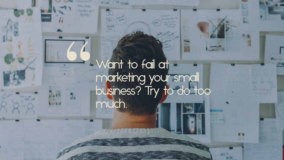 """A man looking at a planning board, with the quote, """"Want to fail at marketing your small business? Try to do too much."""""""