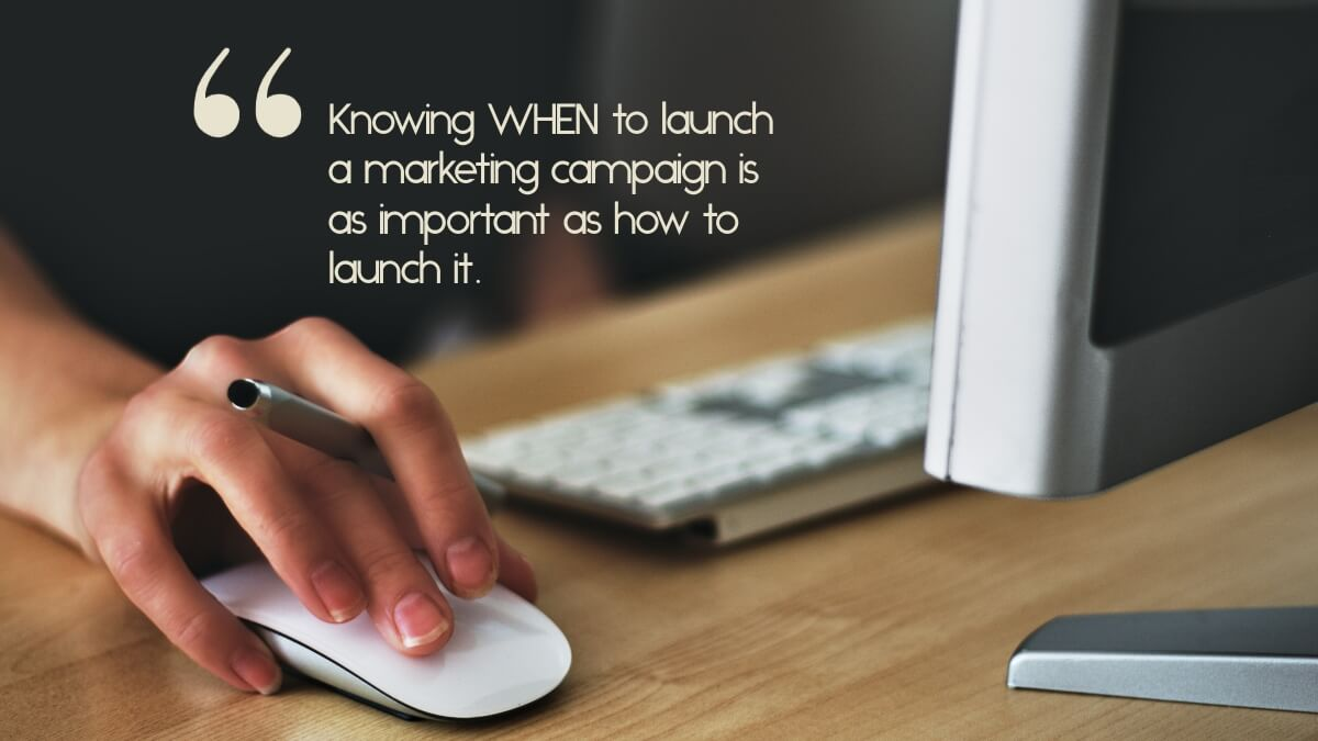 """A person working on a computer, with the caption, """"Knowing WHEN to launch a marketing campaign is as important as how to launch it."""""""